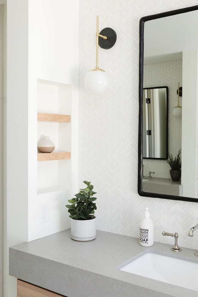 White Oak shelves are tucked into a niche in the wall
