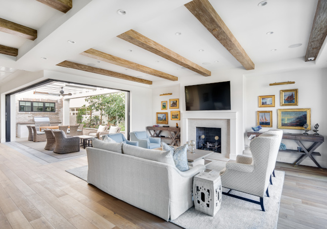 As soon as you enter this California home you notice the retractable patio doors disappear in the Kitchen and Living Room and merge with outdoor spaces