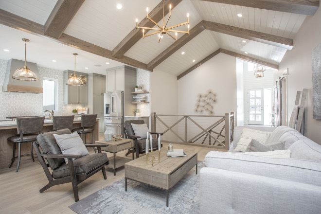 This home was inspired by a modern version of a European farmhouse Calming neutrals with warm wood tones make their way into all the finishes and furniture selections #home #Farmhouseinspired #Europeanfarmhouse #Calmingneutrals #neutrals #warmwood #woodtones #furniture