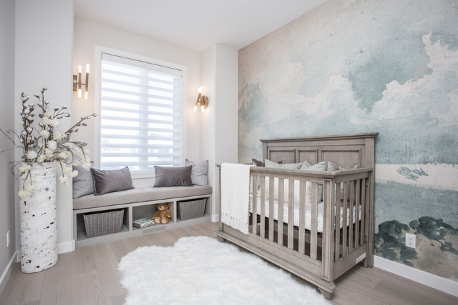 Nursery Mural The mural anchored the room and was complimented by a custom window seat and beautiful wall sconces A faux fur rug and many pillows were added for soft textures #nursery #Nurserydecor #mural