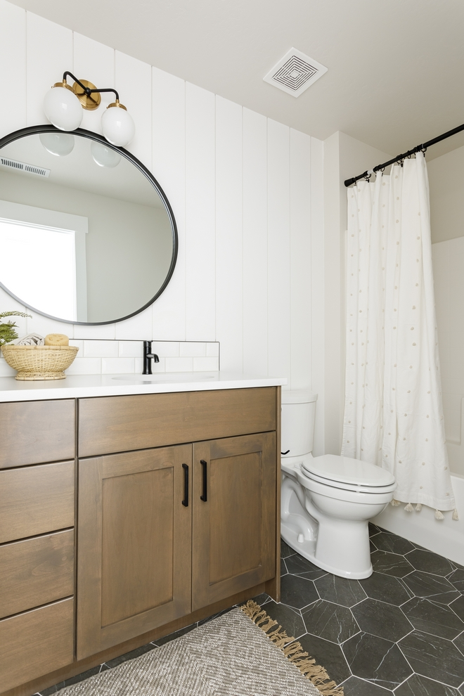 Bathroom Ideas Vertical shiplap is complemented by Petra Marble Hexagon tiles and a custom vanity in a warm tone