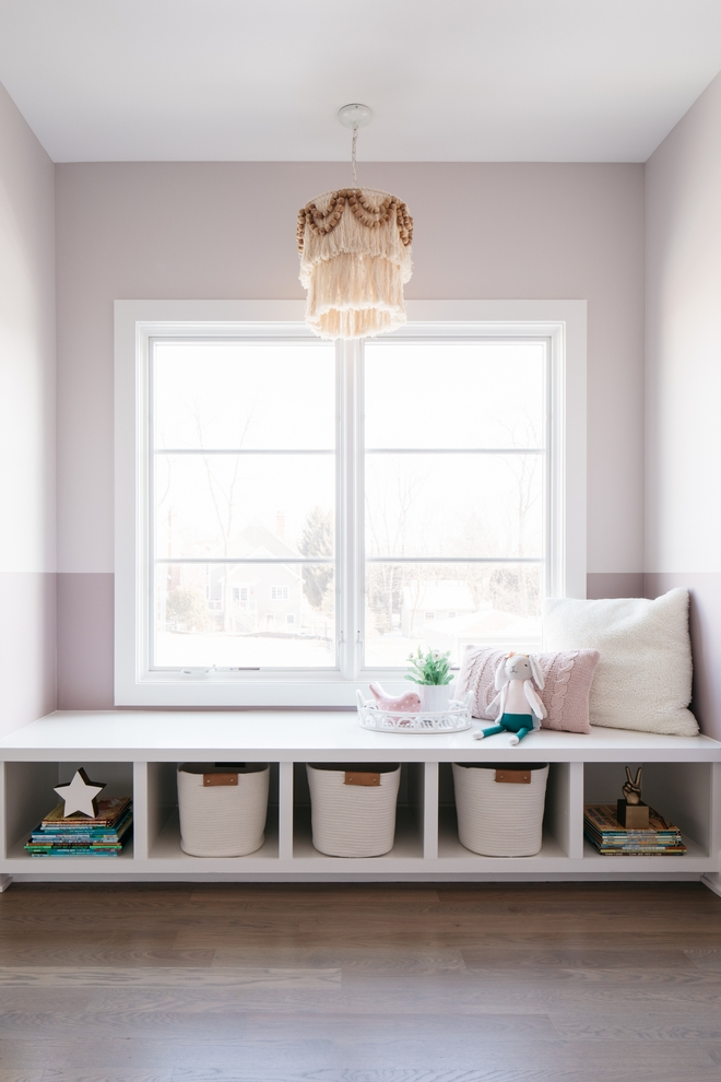 """Two toned girl's bedroom paint color Painters tape line at 42"""" Sherwin Williams Individual White SW 6008 above and Sherwin Williams Intuitive SW 6017 below"""