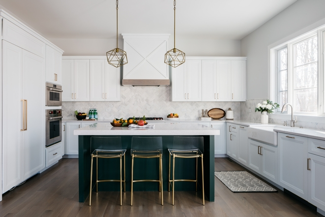 From the color scheme to the easy-to-clean counterstools this kitchen is fun as it is functional Other things to note you won't find glass cabinets in this kitchen nor cabinet knobs