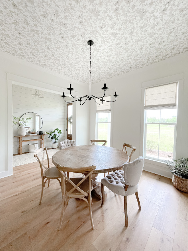 A dining room located just off the foyer features a neutral trendy floral ceiling wallpaper Ceiling Wallpaper Ceiling Wallpaper Ideas #diningroom #trendy #wallpaper #ceilingwallpaper