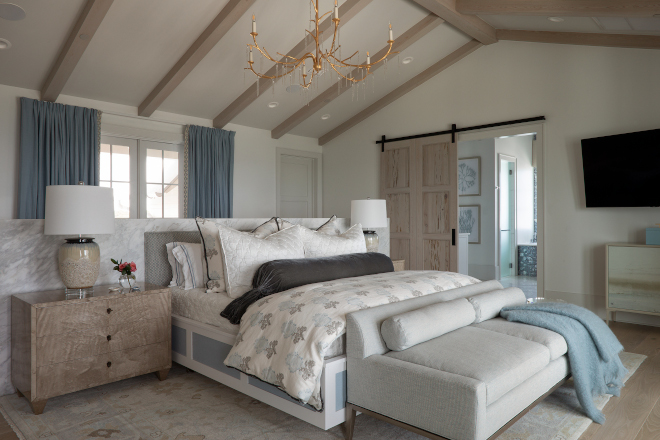 Featuring a custom marble wall with cabinets on the other side and dreamy ocean views, this truly is the ultimate beach house bedroom