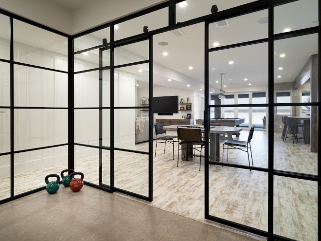 Home Gym The fitness room on the lower level is also enclosed with steel framed glass and sliding doors Home Gym Home Gym Home Gym The fitness room on the lower level is also enclosed with steel framed glass and sliding doors Home Gym Home Gym #HomeGym #fitnessroom #steelenclosed #steelframedglass #slidingdoors
