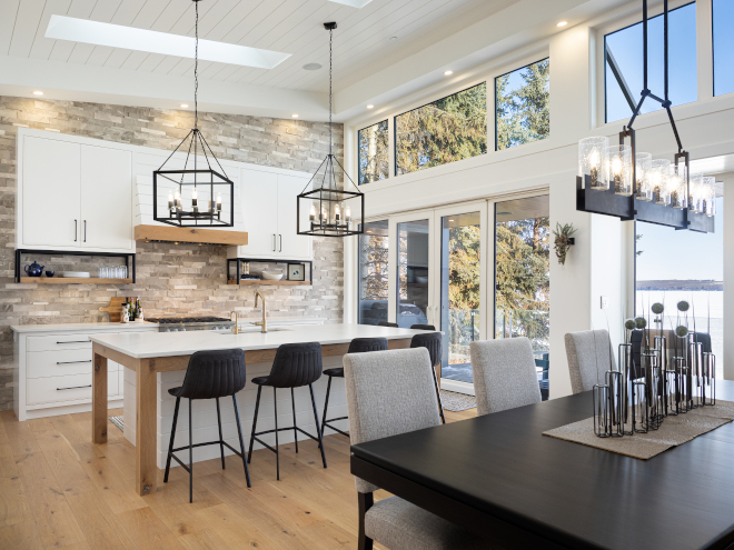 Kitchen Skylighht Kitchen Windows Large windows and multiple skylights bring an abundance of natural light into the kitchen and dining room #Kitchen #Skylighht #Kitchenskylight #KitchenWindows #Largewindows #skylights #naturallight #diningroom