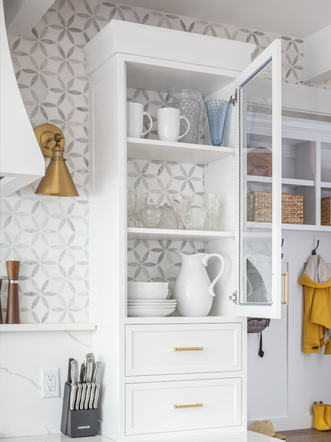 Leaving the back of the upper cabinet open and adding the same backsplash tile adds interest and it extends this entire wall giving the impression of a bigger space