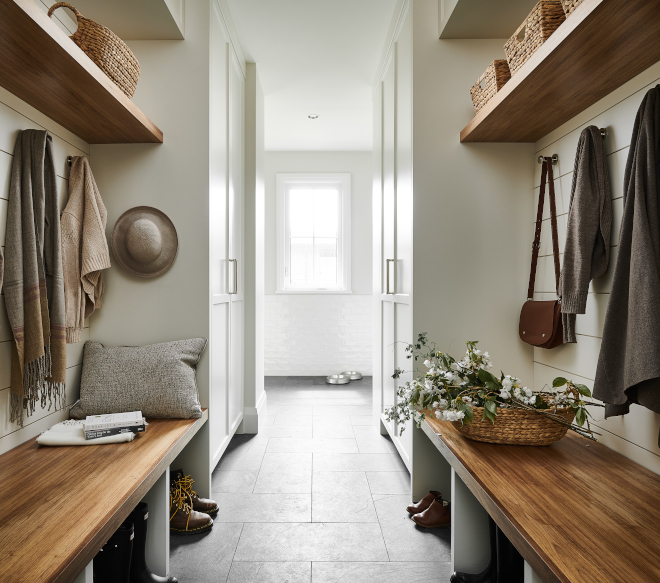 Mudroom custom cabinetry optimizes floor to ceiling storage with custom Walnut built in bench Mudroom #Mudroom #customcabinetry #floortoceiling #storage #Walnutbench #walnutshelf #builtinbench #Mudroombench
