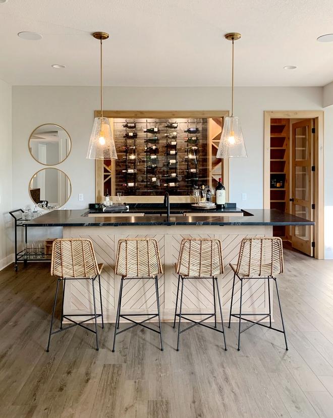 Bar Basement Bar Bar island has a custom chevron detail and a window showcases the Wine Cellar with Pine shiplap walls Bar Basement Bar Bar island #Bar #Basement #BasementBar #Barisland #Winecellar