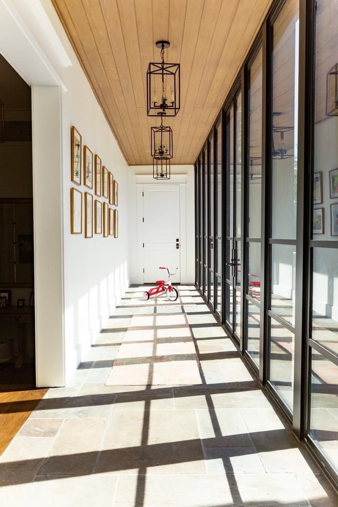 Hallway windows Floor-to-ceiling windows and door in long hallway with bluestone flooring and white oak shiplap ceiling #Hallway #windows #Floortoceilingwindows #door #longhallway #bluestone #flooring #whiteoak #shiplap #ceiling