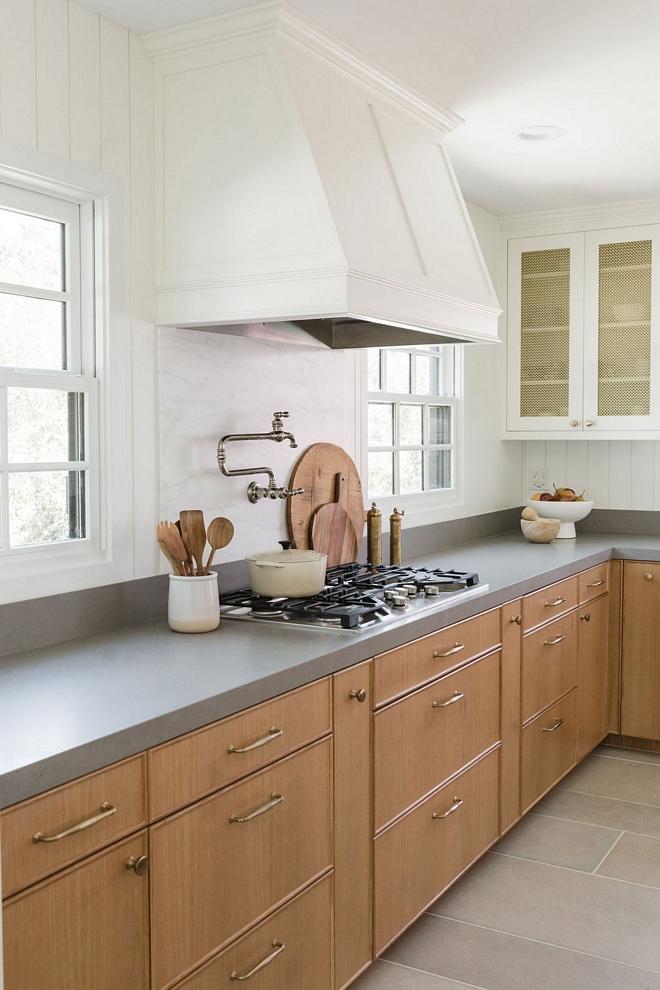 Kitchen backsplash Arizona Tile Calcatta Caldia Slab beneath the hood with MSI Matte Fossil Grey Quartz