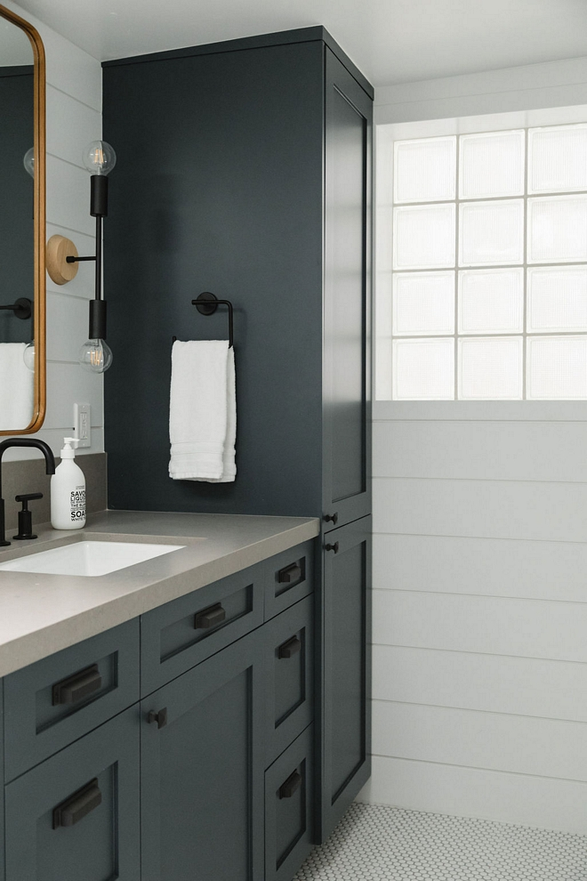 Bathroom Linen Cabinet A custom linen cabinet tower adds more storage to this bathroom