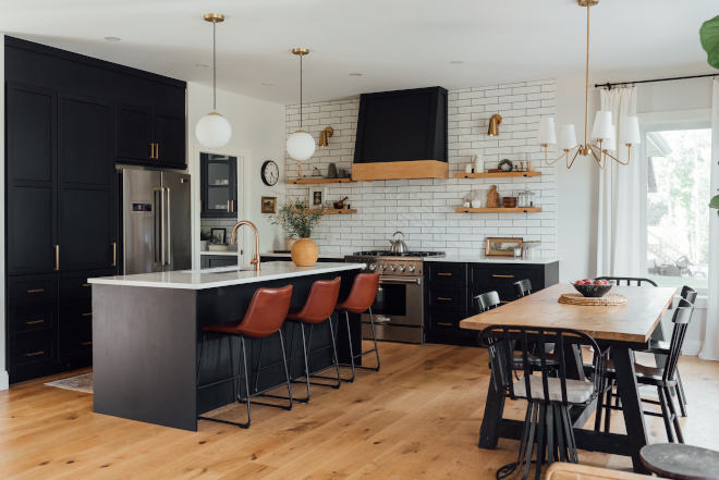 Black Kitchen We went bold in our kitchen with black cabinets but felt balanced with the floors and the wall color It's the perfect anchor to our open concept living space Black Kitchen Black Kitchen #BlackKitchen #blackcabinets #kitchen