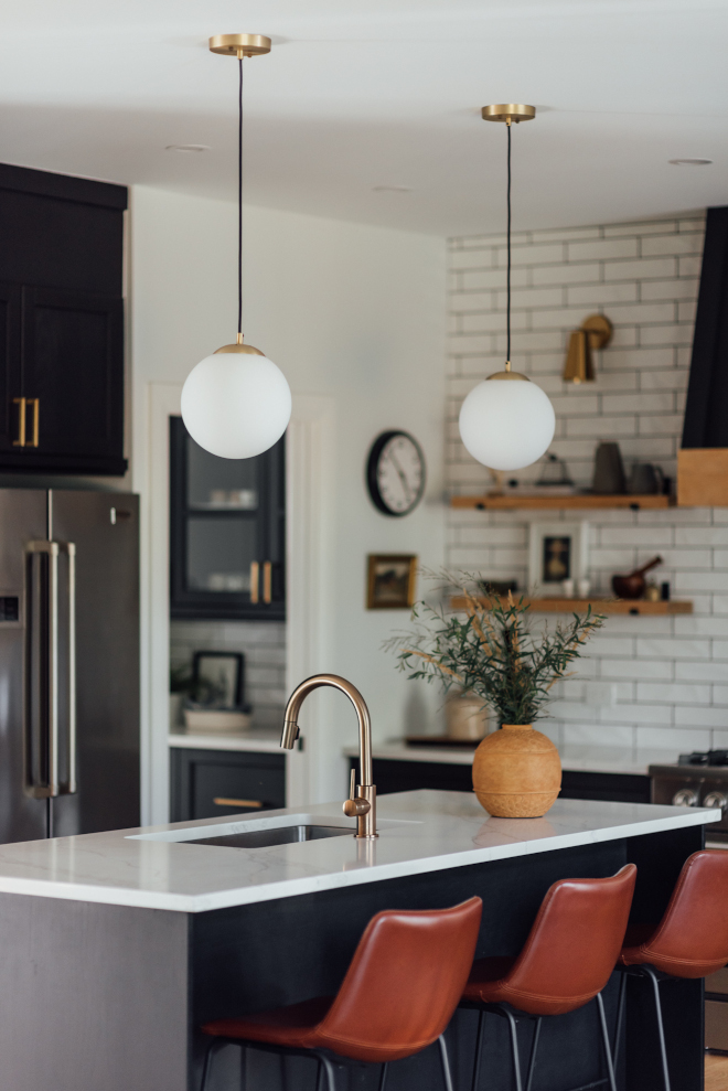 Black Modern Farmhouse Kitchen with Brushed brass with milk glass pendant and Saddle Leather Counterstool Black Modern Farmhouse Kitchen with Brushed brass with milk glass pendant and Saddle Leather Counterstool #BlackModernFarmhouseKitchen #ModernFarmhouseKitchen #Brushed #brasspendant #milkglasspendant #SaddleLeatherCounterstool #LeatherCounterstool