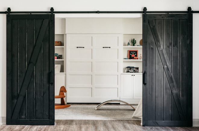 Farmhouse Playroom with double barn doors and murphy bed to be used as a guest bedroom #FarmhousePlayroom #doublebarndoors #murphybed #guestbedroom