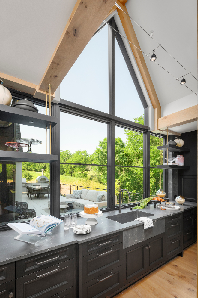 Kitchen Window Kitchen Sink Window Vaulted Ceiling White Oak Trusses frame the stunning windows which open for an extended bar top on the other side #Kitchen #Window #KitchenWindow #SinkWindow #VaultedCeiling #WhiteOakTrusses #windows