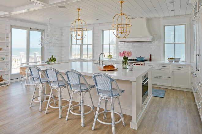 Nothing says beach house, quite like a bright white kitchen and this gourmet kitchen is an entertaining dream Beach house kitchen #beachhouse #beachhousekitchen #beachhouse #brightwhitekitchen #gourmetkitchen