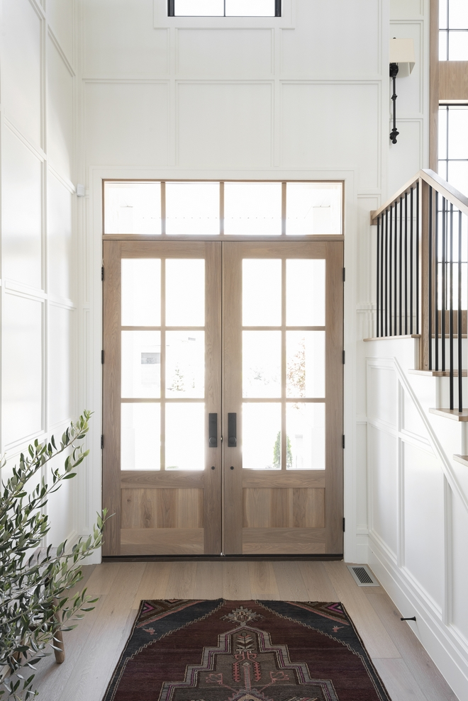 Double wooden front doors welcome you into a breathtaking foyer with plenty of exquisite millwork Double wooden front doors welcome you into a breathtaking foyer with plenty of exquisite millwork Double wooden front doors welcome you into a breathtaking foyer with plenty of exquisite millwork Double wooden front doors welcome you into a breathtaking foyer with plenty of exquisite millwork #Doublewoodendoor #frontdoors #frontdoor #foyer #millwork