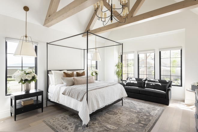 Vaulted ceilings with exposed trusses add character and warmth to this mountain-side bedroom Vaulted ceilings with exposed trusses add character and warmth to this mountain-side bedroom Vaulted ceilings with exposed trusses add character and warmth to this mountain-side bedroom #Vaultedceilings #exposedtrusses #trusses #ceiling #mountainsidebedroom #bedroom