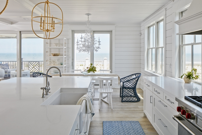 White interiors along with Serena & Lily's furniture gives this beach house a bright and sophisticated coastal vibe