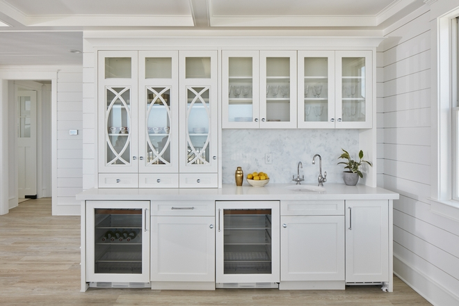 Bar The bar is located in the great room which the designers prefers because it's a natural way to shift everyone away from the island and space out the flow of entertaining #bar #entertaining