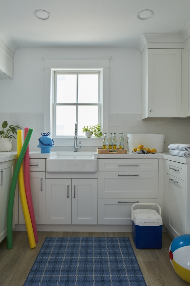 The Beach Prep Room is located in the Basement and it has everything you need to get ready for the beach a beverage fridge low-maintenance Luxury Vinyl flooring Quartz countertop closets where you can store everything from towels to coolers a big sink and even a washer and dryer #beachhouse
