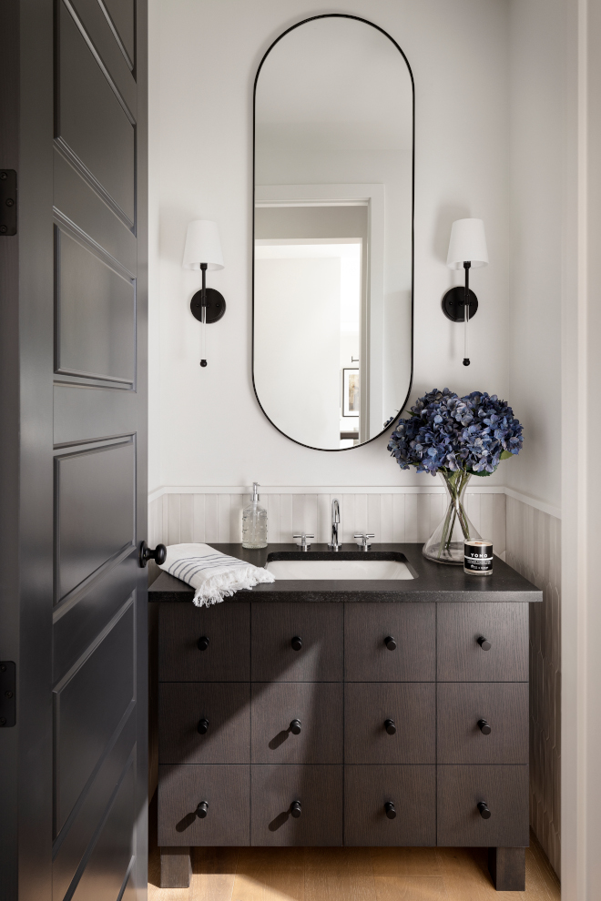 Powder Room features a White Oak vanity with a dark custom stain Picket tile wainscotting and black Pill shaped mirror Powder Room features a White Oak vanity with a dark custom stain Picket tile wainscotting and black Pill shaped mirror Powder Room features a White Oak vanity with a dark custom stain Picket tile wainscotting and black Pill shaped mirror Powder Room features a White Oak vanity with a dark custom stain Picket tile wainscotting and black Pill shaped mirror #PowderRoom #WhiteOakvanity #darkstain #customstain #Pickettile #tilewainscotting #blackPillshapedmirror #Pillshapedmirror