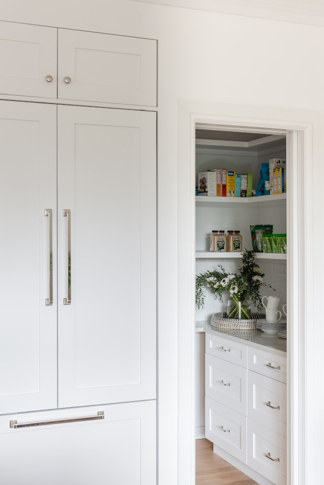 The walk in pantry features a mix of open shelving and cabinets for storage Pocket door provides flexibility of keeping the space open or closed without taking space away #walkinpantry #pantry #openshelving #cabinets #storage #Pocketdoor
