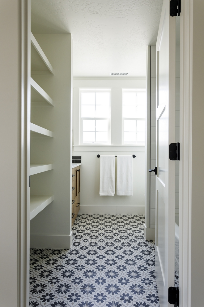 A flower patterned tile along with custom stacked shelves add plenty of character to this Bathroom #flowertile #patternedtile #sackedshelves #Bathroom