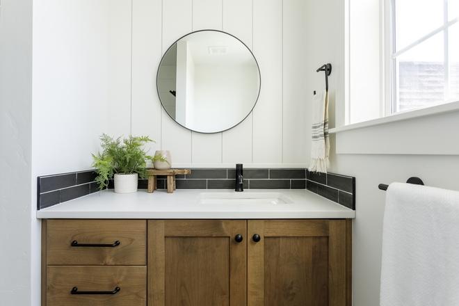 Right beside the custom shelves you will find a custom Oak vanity with vertical shiplap backsplash