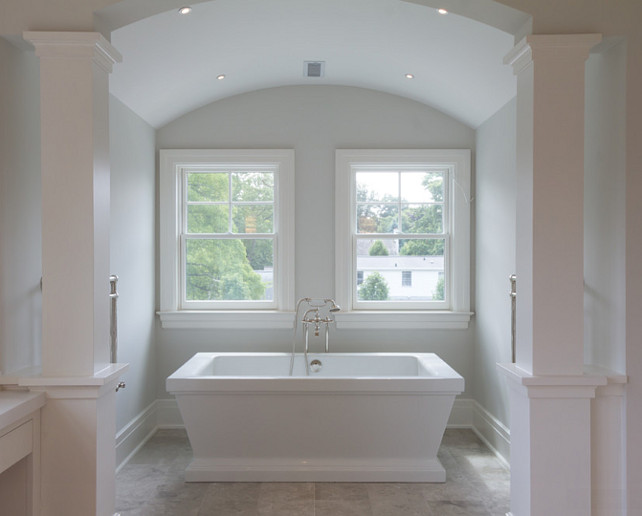 Barrel Ceiling Bath Nook. This master bath boasts heated marble floors, wrap around vanity make-up table with custom mosaic feature wall, steam shower and an air-jetted freestanding spa bath situated in a columned tub alcove. #masterBathroom #Bathroom #BarrelCeiling #Alcove #Nook #bath Blue Water Home Builders.