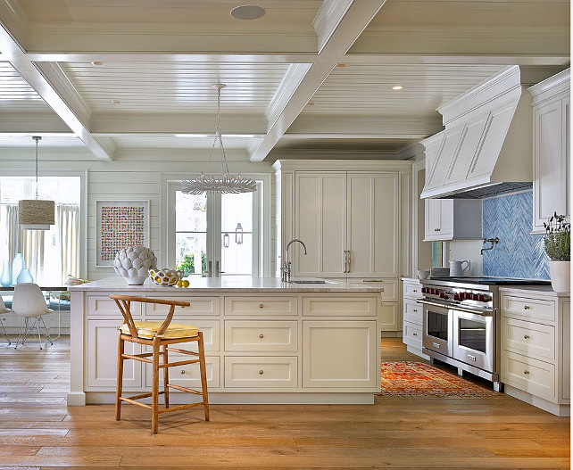 White Kitchen. Beach House White Kitchen Ideas. Wide plank white oak hardwood floors, bright blue backsplash in herringbone pattern, coffered ceiling, shiplap ceiling, wishbone counter stool, tongue and groove walls. #kitchen #Whitekitchen #Shiplap Cronk Duch Architecture.