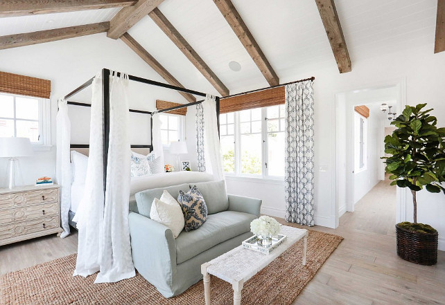 Master Bedroom. Coastal master bedroom. Coastal master bedroom with beams and vaulted ceiling, shiplap ceiling, plank floors, four-posted bed and coastal bedding and decor. #MasterBedroom #CoastalMasterBedroom Blackband Design.