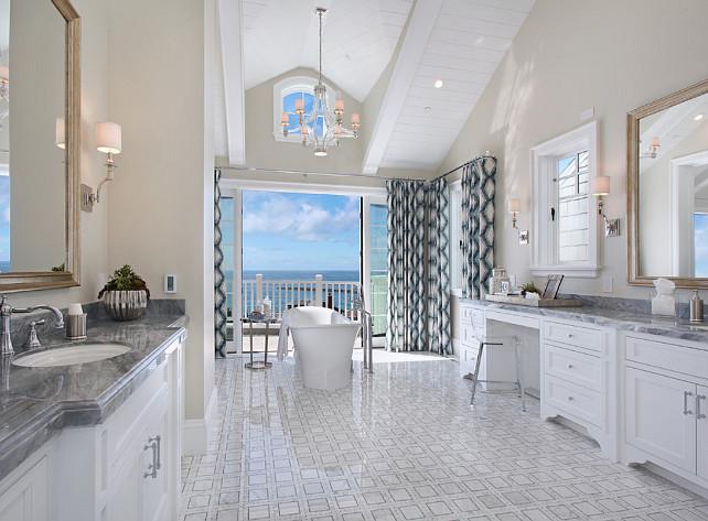 Master Bathroom. Master bathroom Design. Coastal master bathroom. Master Bathroom bathtub, bathtub with a view, chandelier, bathroom ocean view, Tile. #Bathroom #MasterBathroom #CoastalInteriors Spinnaker Development.