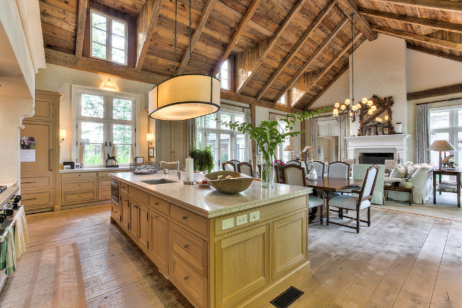 French Country Home Interiors. French Country Home Interior Ideas. The kitchen opens to a stunning great room. I am loving the plank hardwood floors and the reclaimed barn wood ceiling. French Country Home Interior Design. French Country Home Interior Pictures. French Country Home Interiors. #FrenchCountry #Home #Interiors. Sotheby's Canada.