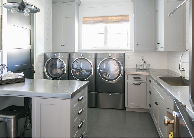 Laundry room. Industrial style laundry room with gray cabinets and muiltiple machines. #LaundryRoom #GrayCabinet #PaintColor #LaundryRoomIdeas #LaundryRoomCabinet #Industrial #DoubleMachineLaundryRoom Brooke Wagner Design.