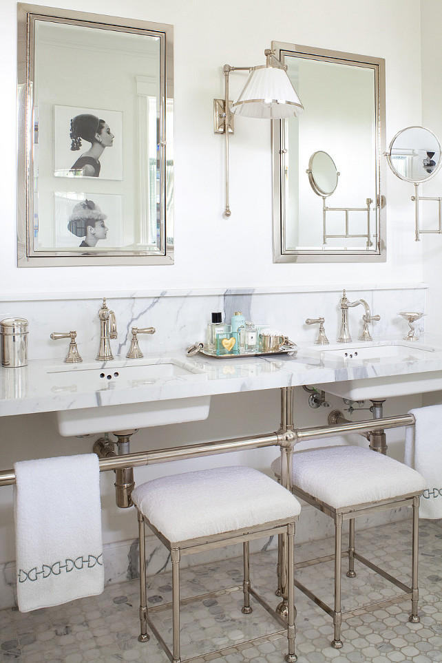 Double Vanity Bathroom. Stunning master bath with polished nickel and marble double bathroom washstands with his and her sinks and polished nickel vintage bathroom faucets. Restoration Hardware Newbury Bath Stools tucked under 3-leg bathroom vanity and marble mosaic bathroom tile floor, Restoration Hardware Framed Inset Medicine Cabinets in Polished Nickel. Restoration Hardware Asbury Extension Mirror, polished nickel bathroom sconces with white pleated shade and black and white photos of Audrey Hepburn. Anne Hepfer Designs.