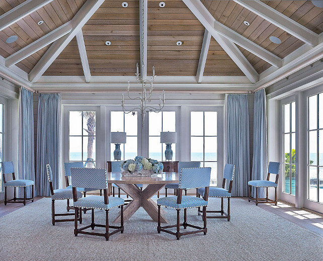 Dining Room. Coastal Dining room. Dining room with blue and white decor, blue curtains, blue dining chairs, round table, vaulted ceiling. #DiningRoom #Coastal Cronk Duch Architecture.