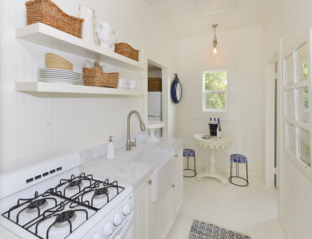 Small White Kitchen. Small All white Cottage kitchen. Small all white kitchen. Small white kitchen with white cabinets, white open shelves, white painted floors and white stove. #Allwhitekitchen #whitekitchen #Smallwhitekitchen #SmallKitchen #CottageKitchen