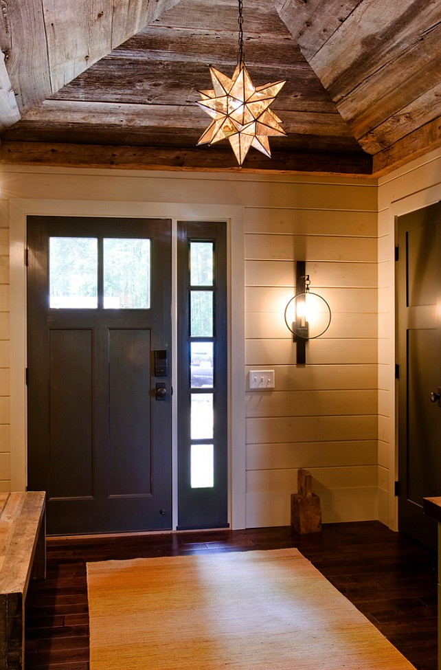 Rustic Foyer with reclaimed Wood ceiling. The wall sconce is the Visual Comfort Gilded Iron with Wax Suzanne Kasler 1 Light Alice Wall Sconce in Aged Iron. The pendant is the Moravian Star Pendant. Barn wood ceiling. Barn wood ceiling foyer. #ReclaimedWood #BarnWood #Ceiling #Foyer Kristina Crestin Design.