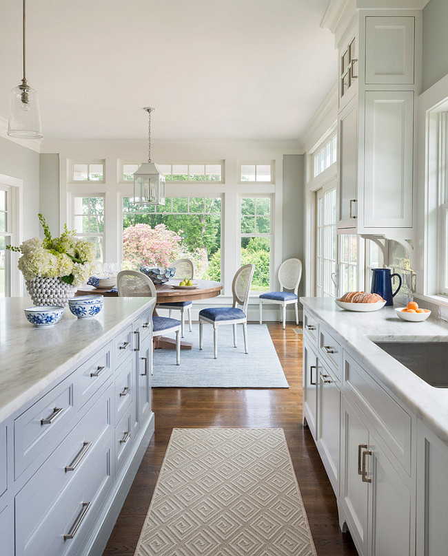 White And Gray Kitchen With Navy Blue Accents Features Cabinets