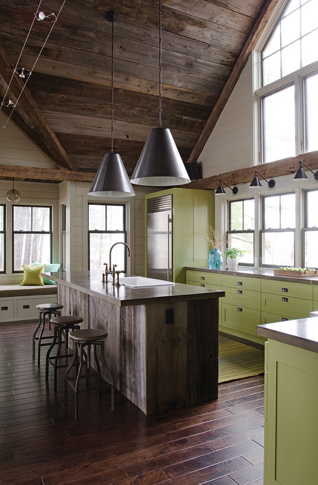 Rustic kitchen with plank wood island. Rustic kitchen with green cabinets, reclaimed wood ceiling, plank wood island with Soapstone countertop. #Kitchen #Rustic #Reclaimed #Plank #PlankWoodIsland #PlankIsland OLSON LEWIS + Architects.