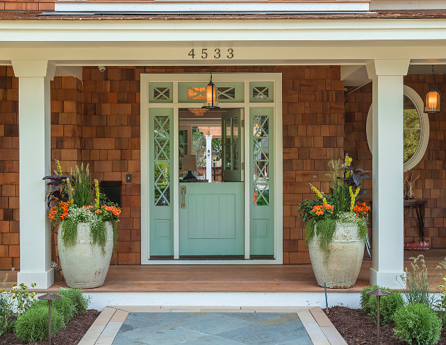 Front Entry. Front Entry and Front Door Ideas. Front Entry with Dutch Doors painted in Wythe Blue by Benjamin Moore. Front entry door paint color and planters. #FrontEntry #FrontDoor #PaintColor #Planters #BenjaminMooreWytheBlue Great Neighborhood Homes.