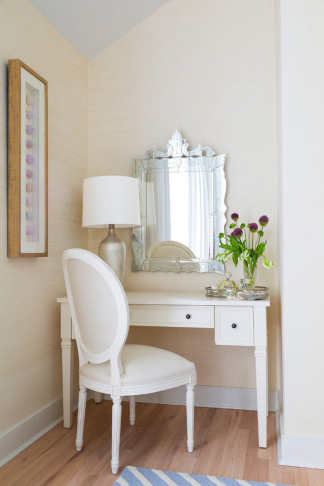Master bedroom vanity area. Venetian mirror and artwork featuring sea urchins displayed on wall. Louis style chair and white vanity. Grasscloth wallpaper on all walls. #Vanity #Bedroom #VanityArea #MasterBedroom Chango & Co.