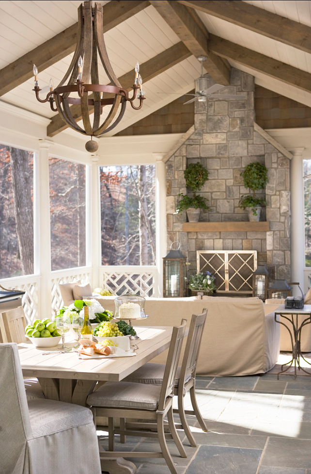 outdoor porch with stone fireplace