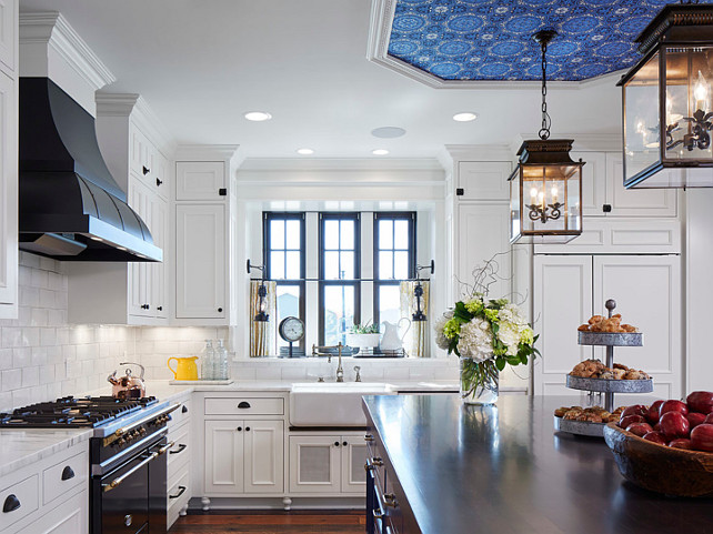 French Country Kitchen. This faucet is the Towson Kitchen Faucet with Side Spray in a Distressed Antique Brass Finish. White French Country Kitchen. French Country Kitchen Ideas. This French Country Kitchen is painted in Benjamin Moore White Dove. French Country Kitchen Design. French Country Kitchen Layout. #FrenchCountryKitchen #FrenchCountry #Kitchen Martha O'Hara Interiors.