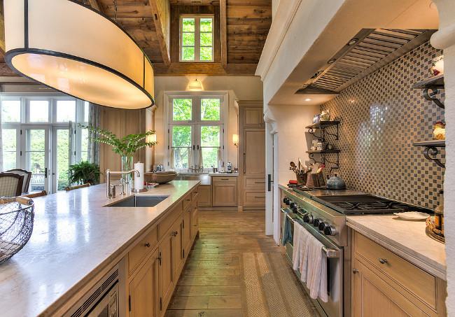 Kitchen. French Country Kitchen. French Country Kitchen Countertop. French Country Kitchen Limestone Hood. French Country Kitchen Plank Floors. French Country Kitchen Reclaimed Ceiling. #FrenchCountry #Kitchen