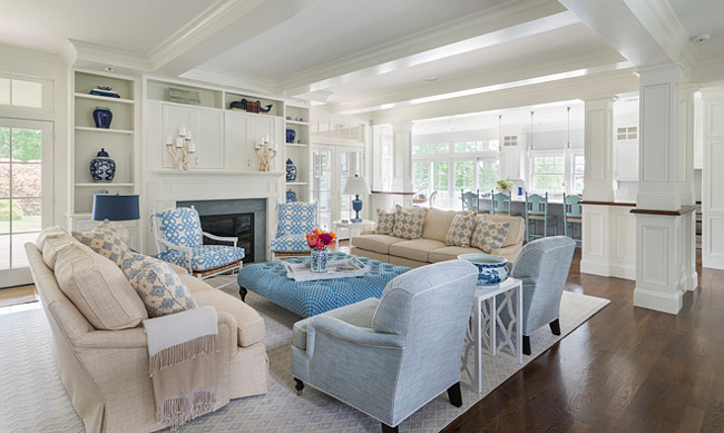 Coastal home with open main floor. The main floor of this coastal home feels open and airy. The living room opens to the kitchen. #OpenFloorplan #OpenmainFloor #OpenConcept #OpenLayout #CoastalHome Digs Design Company.
