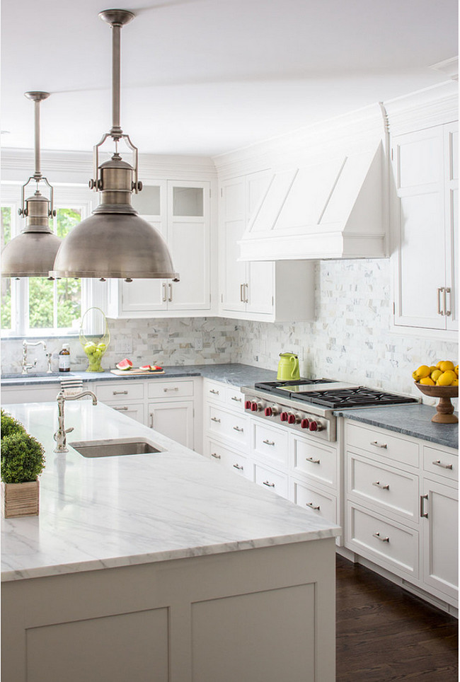 White and gray countertop. Kitchen White and gray countertop. Gray and white is a popular color combination for white kitchens. Island is Calacatta Gold Marble in Honed Finish. Perimeter is Classic Soapstone which was selected for its durability and soft grey color. Connecticut Stone.